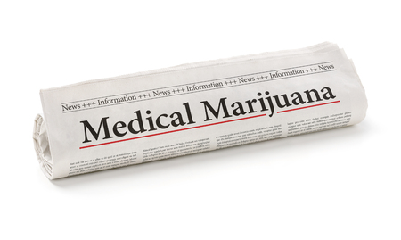 Rolled newspaper with the headline Medical marijuana Фото со стока - 123800877