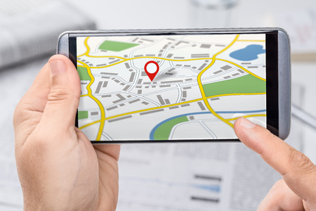 Smartphone with a generic city map with a pin