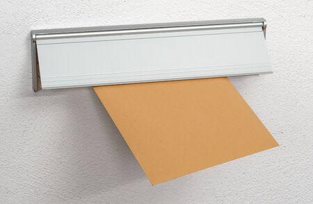 A brown envelope in a letterbox Reklamní fotografie