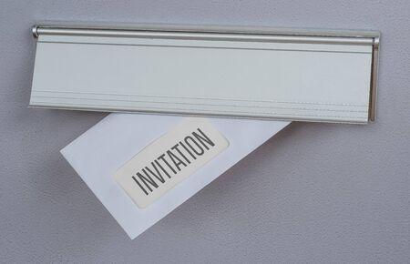A letter in a mail slot - Invitation Reklamní fotografie