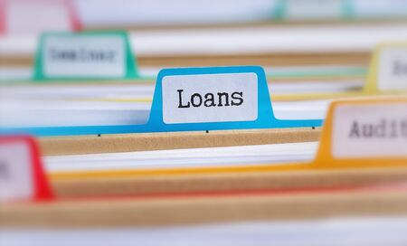 File folders with a tab labeled Loans
