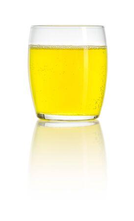 Glass filled with an orange soft drink Reklamní fotografie
