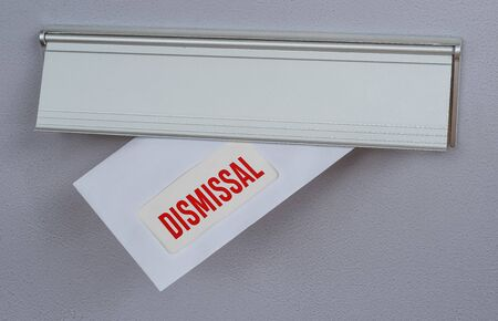 A letter in a mail slot - Dismissal Stock Photo