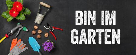 Garden tools on a dark background - I am in the garden - Bin im Garten (German)