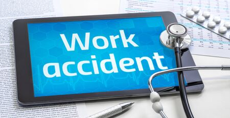 The word Work accident on the display of a tablet