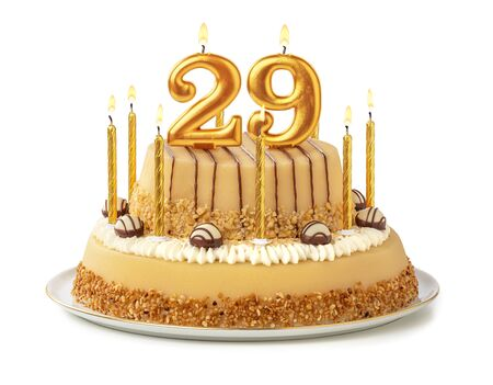 Festive cake with golden candles - Number 29 免版税图像