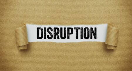 Torn brown paper revealing the word Disruption