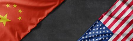 Flags of China and the United States of America with copy space