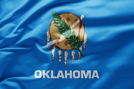 Waving state flag of Oklahoma - United States of America Imagens