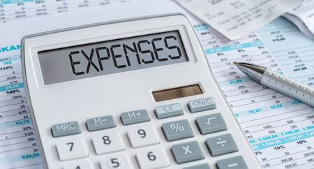 A calculator with the word Expenses on the display Banco de Imagens