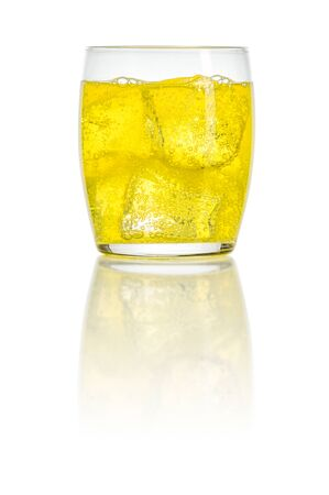An orange soft drink with ice cubes