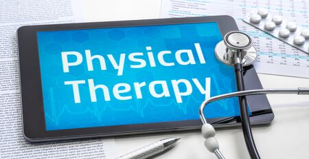 The word Physical Therapy on the display of a tablet Stock fotó