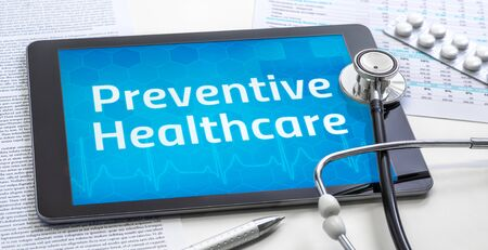 The word Preventive Healthcare on the display of a tablet