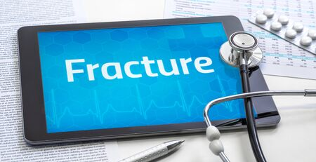 The word Fracture on the display of a tablet