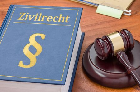 A law book with a gavel -  German Translation of Civil Code -Zivilrecht