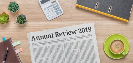 A newspaper on a desk with the headline Annual review 2019