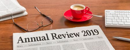 A newspaper on a wooden desk - Annual review 2019