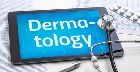 The word Dermatology on the display of a tablet