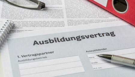 An Apprenticeship agreement with a pen on a desk - Ausbildungsvertrag (German) Banco de Imagens
