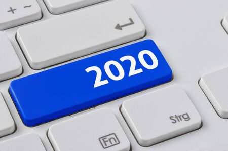 A keyboard with a blue button - 2020