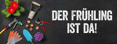Garden tools on a dark background - Spring is here - Der Fruehling ist da (German)