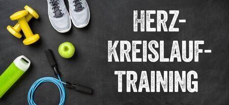 Fitness equipment on a dark background - Cardiovascular Workout - Herz-Kreislauf-Training (German)