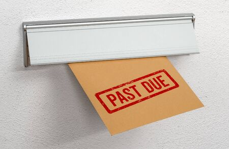 A letter stamped Past due in a mail slot