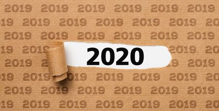 Torn  paper revealing the number 2020