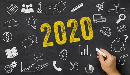 2020 written on a blackboard with icons