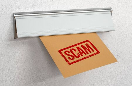 A letter stamped Scam in a mail slot