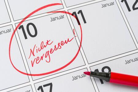 Save the Date written on a calendar - January 10 -  Nicht vergessen in german