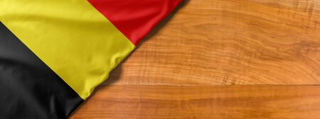 National flag of Belgium on a wooden background with copy space