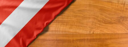 National flag of Austria on a wooden background with copy space Banco de Imagens