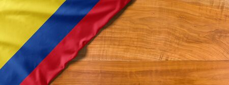 National flag of Colombia on a wooden background with copy space Banco de Imagens