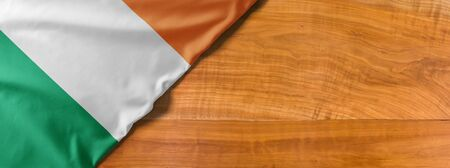 National flag of Ireland on a wooden background with copy space
