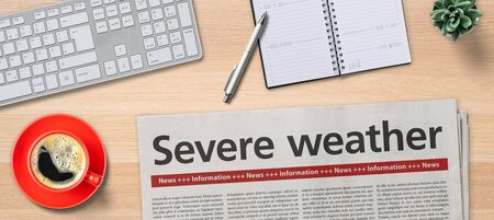 Newspaper on a desk -  Severe weather