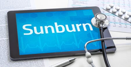 The word Sunburn on the display of a tablet