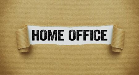 Torn paper revealing the words Home office