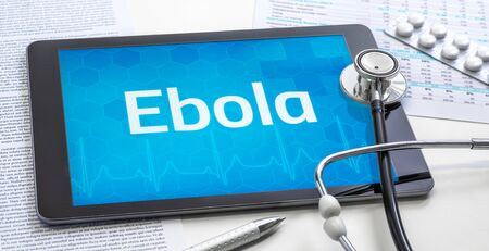The word Ebola on the display of a tablet Standard-Bild