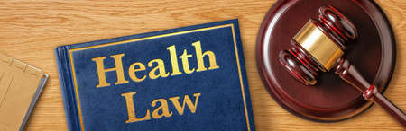 A gavel with a law book - Health Law