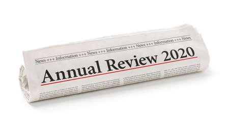 Rolled newspaper with the headline Annual review 2020 Archivio Fotografico