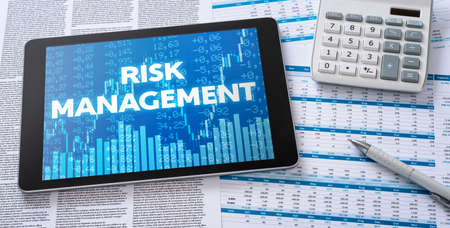 A tablet with financial documents - Risk Management
