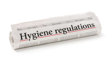 Rolled newspaper with the headline Hygiene regulations