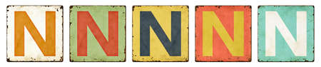 Letter N in vintage tin signs on white