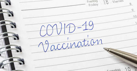 COVID-19 Vaccination written on a calendar page