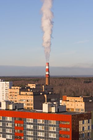 standalone: Stand-alone red-white boiler-house chimney smoking Stock Photo