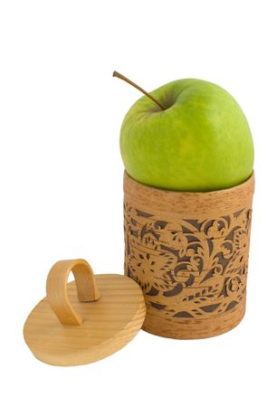 Accurate wooden gift box with a green apple isolated on white photo