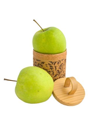 Accurate wooden gift box with two green apples isolated on white photo