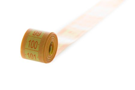 Close-up view of a measure tape isolated on white photo