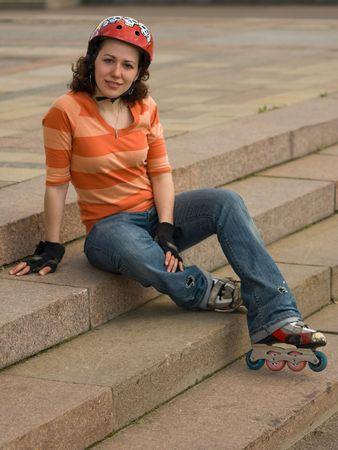 rollerblades: Smiling Rollerskating Girl Sitting on Stair Steps
